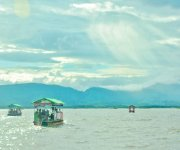 Tourist experiencing Loktak Lake on Boat from Boating Centre at Sendra Chingkhong :: Gallery